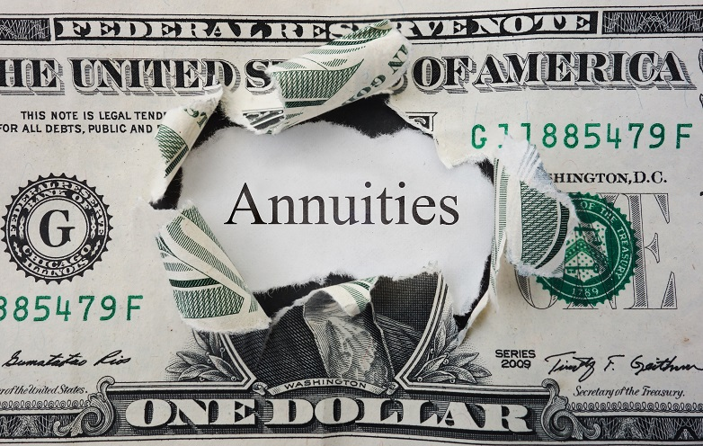 Hole torn in a dollar bill with Annuities text